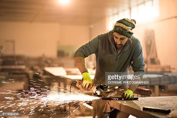 Male grinder in workshop
