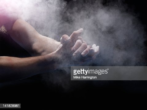 Male Gymnast Chalking His Hands