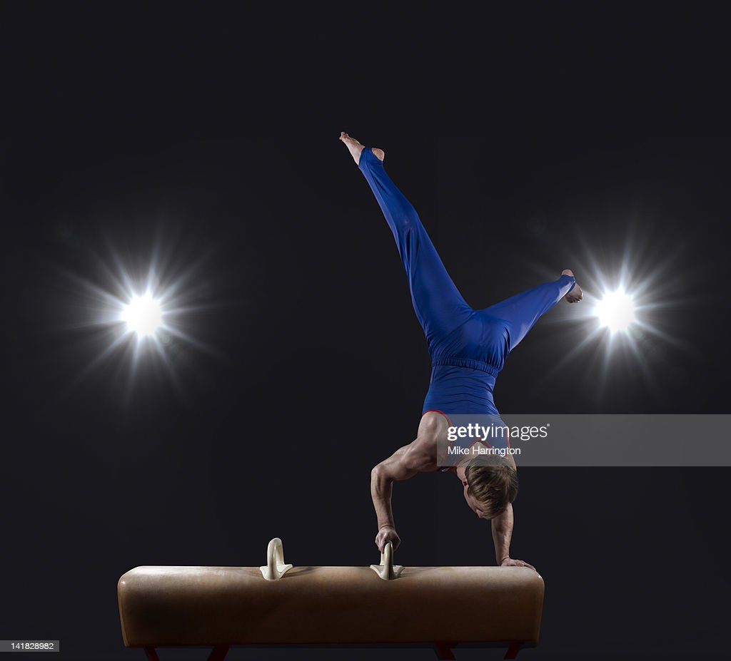 Male Gymnast doing handstand on Pommel Horse : Stock Photo