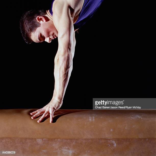 Male Gymnast Springing Off of Gymnastics Vault