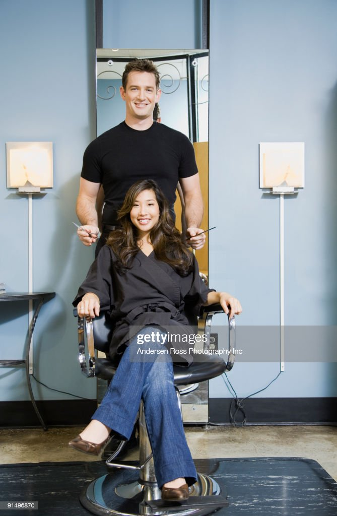 Male hair stylist and client in salon