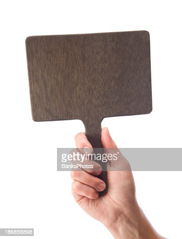 Male Hand Holding a Blank Wood Auction Paddle