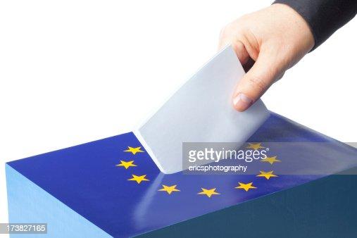 Male hand inserting ballot to EU ballot box