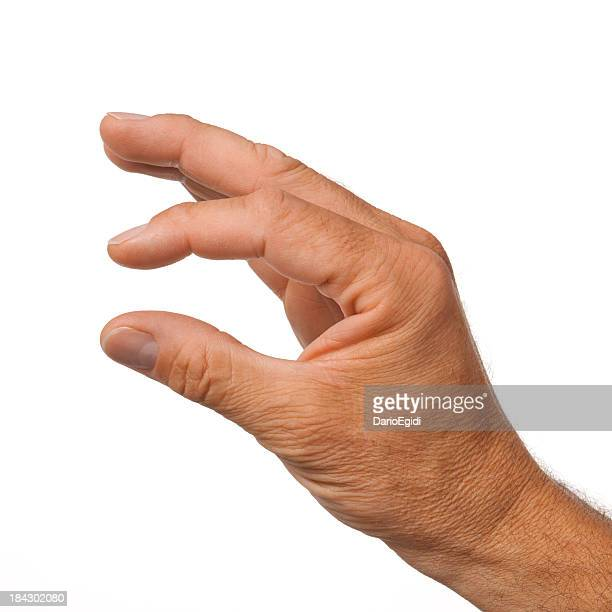 Male hand making the gesture of a little bit