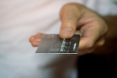 close up of male hand hold credit card