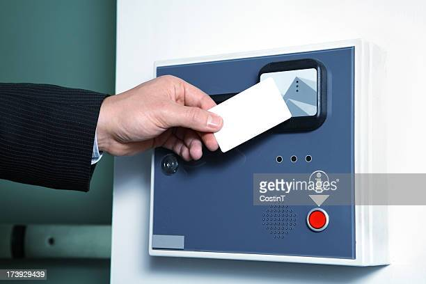 Male hand swiping cardkey.