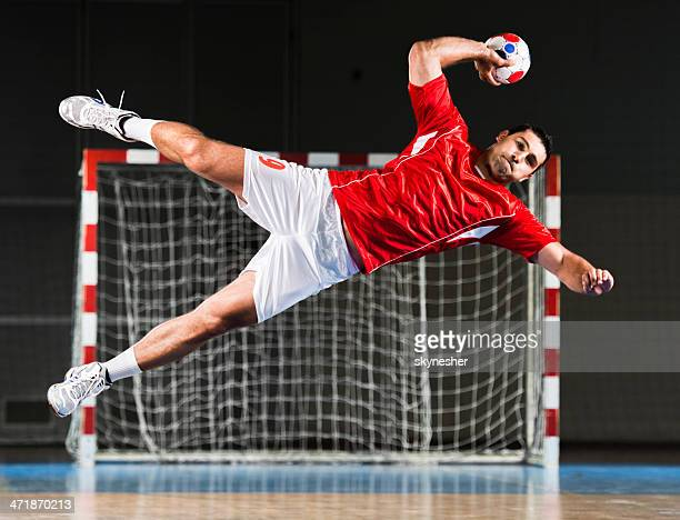 Male handball player in action.