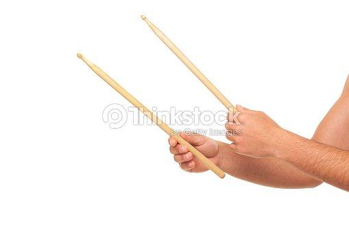 Hand Holding Stick ~ Male hands holding drum sticks stock photo thinkstock