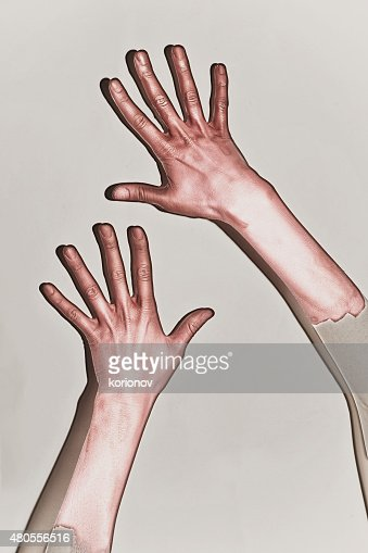 Male hands painted in red paint : Stock Photo