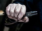 Vintage metal tool are in men's hands.