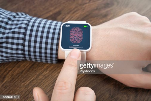 male hands white smartwatch with a fingerprint : Stock Photo