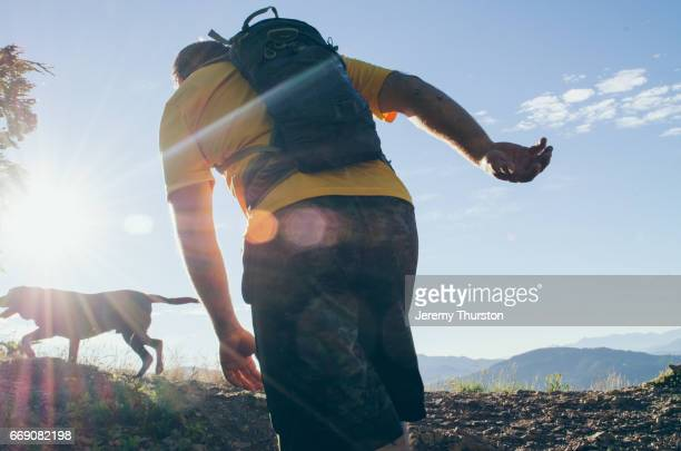male hiker and dog enjoying early morning adventure