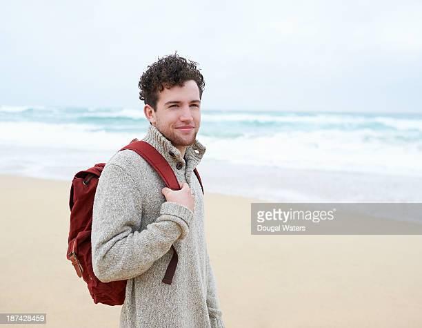 Male hiker at beach.