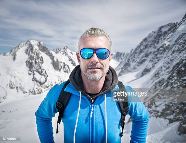 Male hiker in a snow mountain