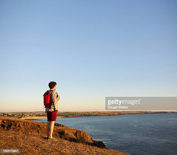 Male hiker looking out to sea.