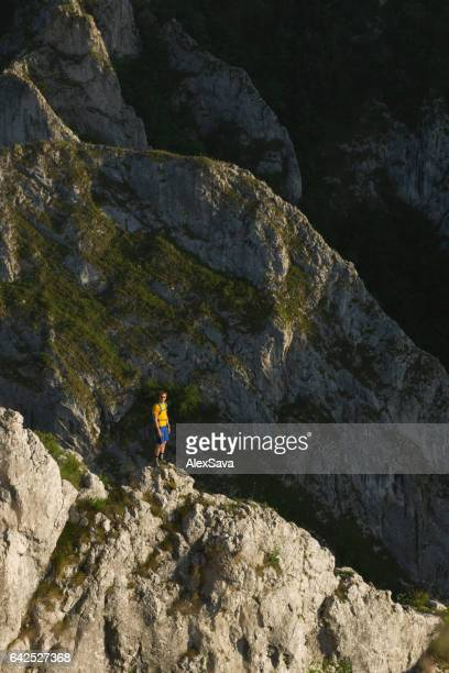 Male hiker standing on a high cliff