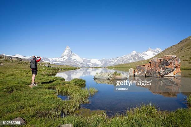 Male hiker takes a selfie of himself
