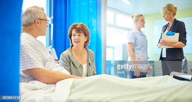 male hospital patient and wife waiting for news