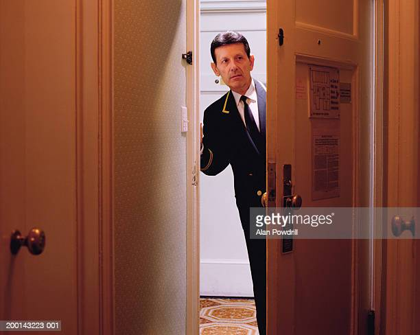 Male hotel porter in doorway