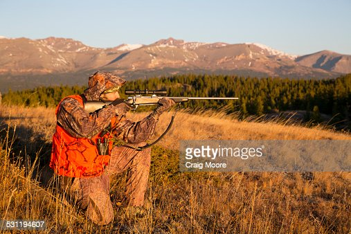 A male hunter at sunrise.