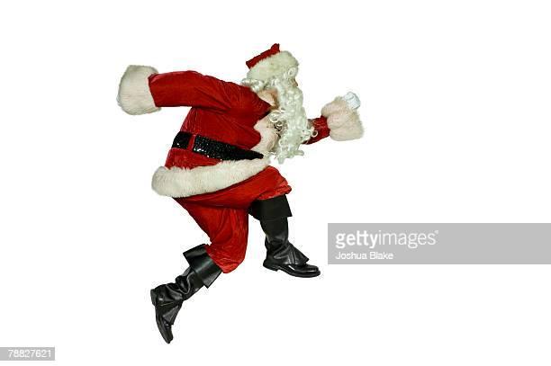 Male in santa suit running.