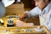 Male jeweler working in studio
