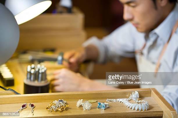 Male jeweler working in studio