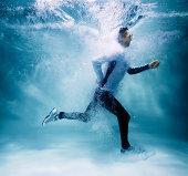 Male jogger running underwater