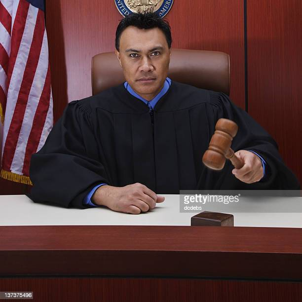 Male Judge With Gavel in Courtroom