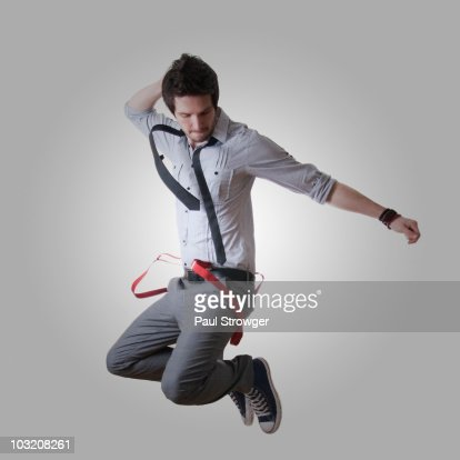 Male Jumping with Red Braces : Stock Photo