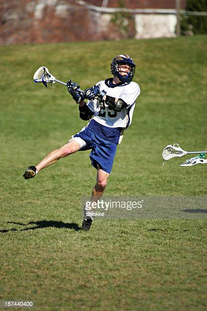 Male Lacrosse Player Jumps into a Shot on Goal