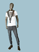 Full length male mannequin dressed in t-shirt and gray jeans, isolated. No brand names or copyright objects.