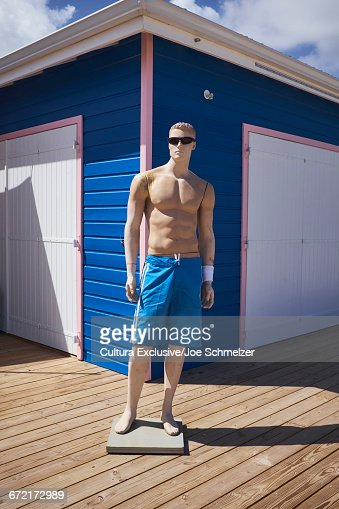 Male mannequin wearing sunglasses and shorts outside beach hut, Saint Martin, The Caribbean