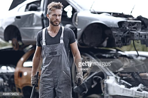 Male mechanic at junkyard