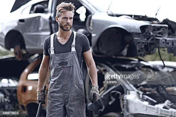 Male mechanic at junkyard