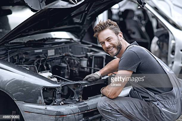 Male mechanic fixing car