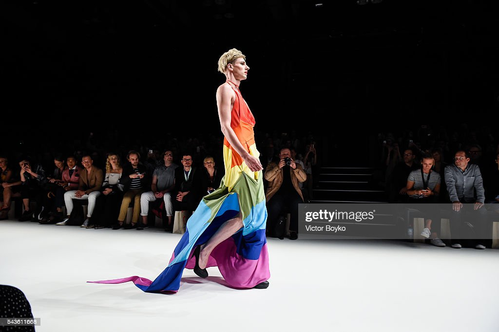A male model dressed in a rainbow colour outfit walks the runway at the Anja Gockel show during the Mercedes-Benz Fashion Week Berlin Spring/Summer 2017 at Erika Hess Eisstadion on June 29, 2016 in Berlin, Germany.