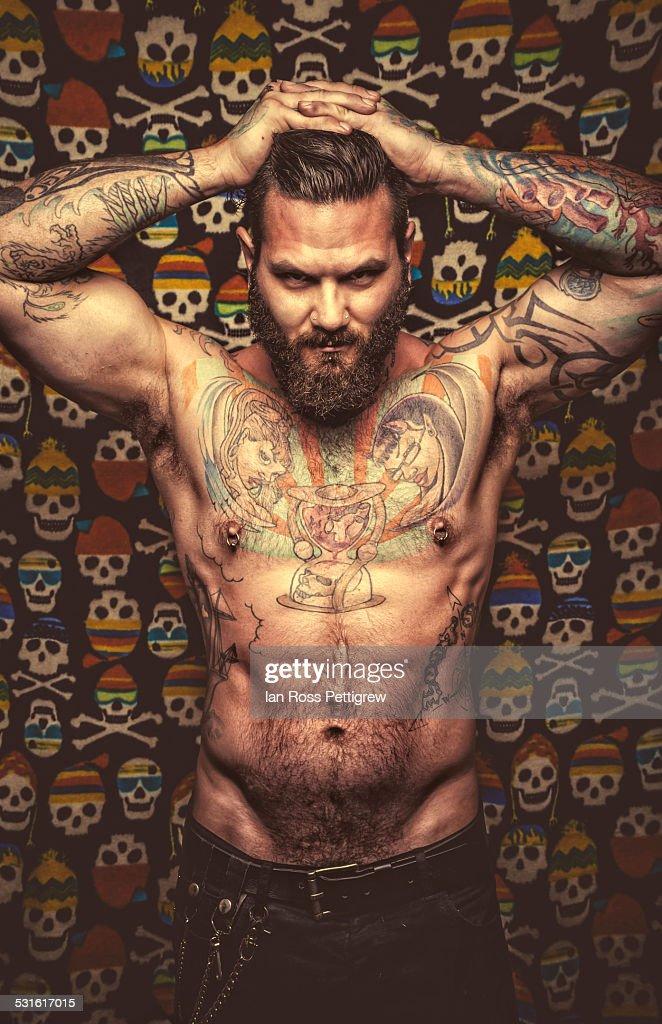 Male model posing on skull background