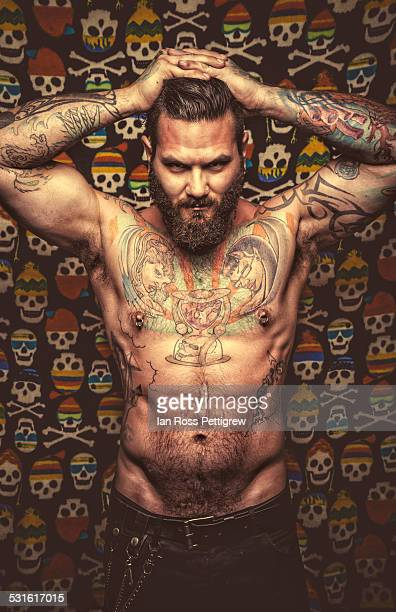 Male model posing on skull background