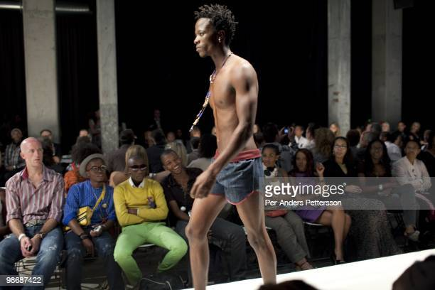 A male model walks on the catwalk during a show at the Sanlam fashion week on April 4 Turbine Hall in central Johannesburg South Africa Buyers and...