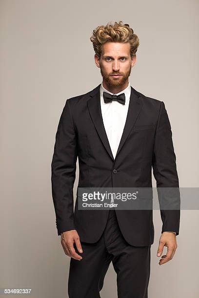 Male Model with beard  in suit and bow tie