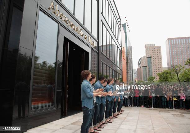 Male models cheer at the Abercrombie Fitch Shanghai Flagship Store Opening on April 19 2014 in Shanghai China