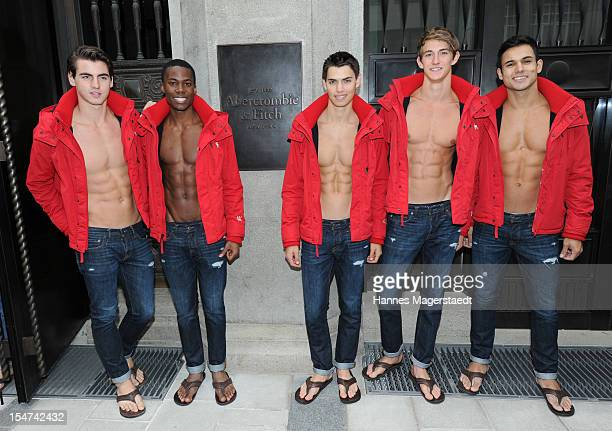 Male models pose outside the Abercrombie Fitch flagship clothing store before the opening of Abercrombie Fitch Munich flagship store on October 25...