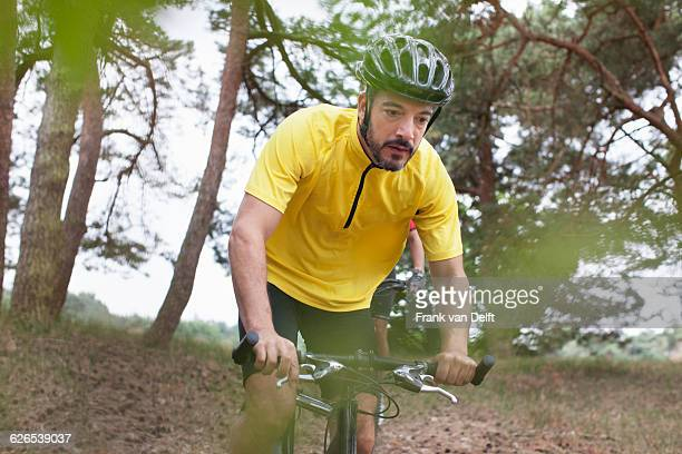 Male mountain biker in forest