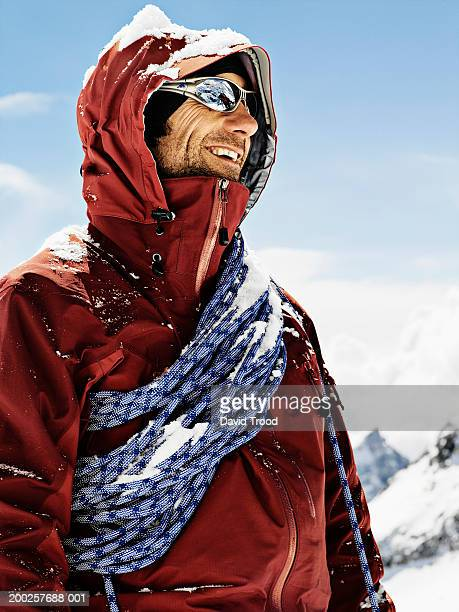Male mountain climber wearing sunglasses, smiling, close-up