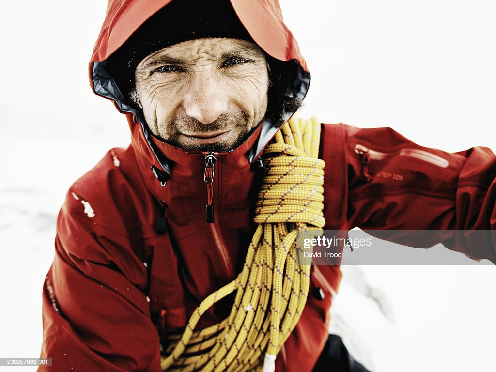 Male mountain climber with rope over shoulder, close-up, portrait
