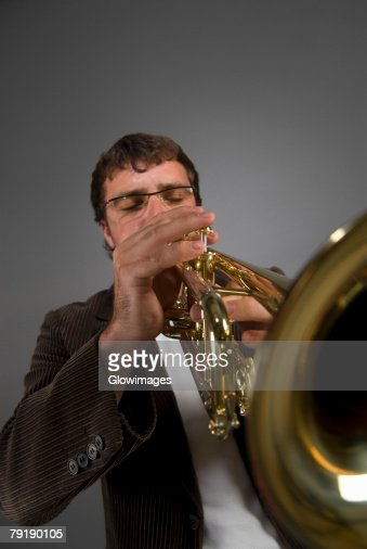 Male musician playing a trumpet : Stock Photo
