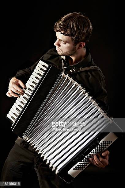 male musician playing accordion