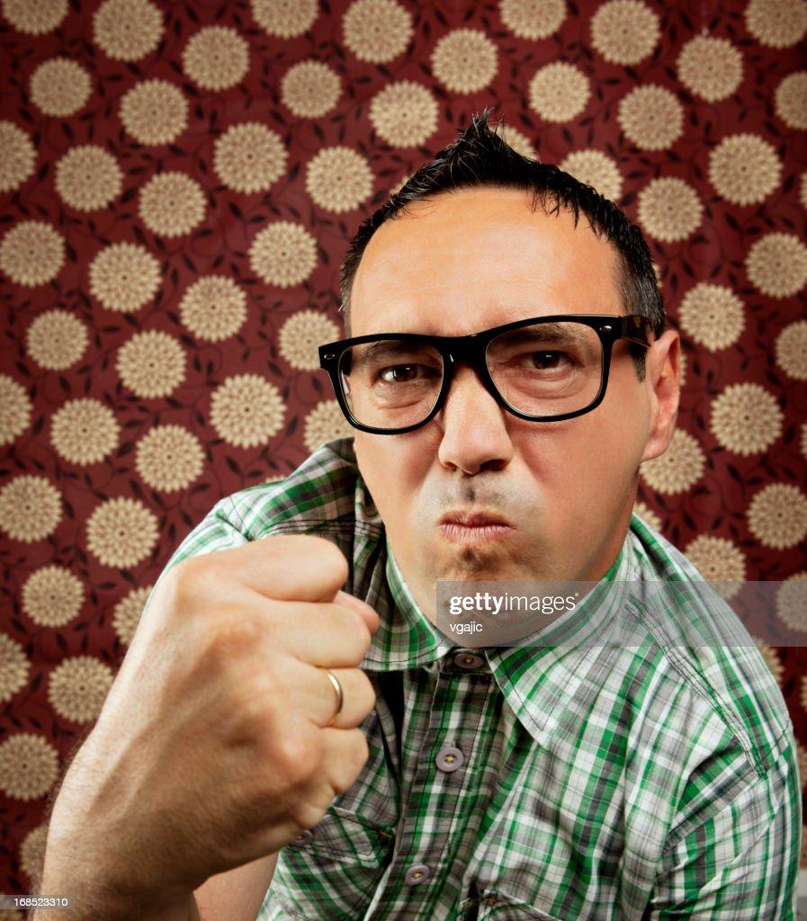 Male Nerd Showing Fury Fist : Stock Photo