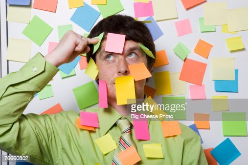Male office worker covered with sticky notes : Stock-Foto